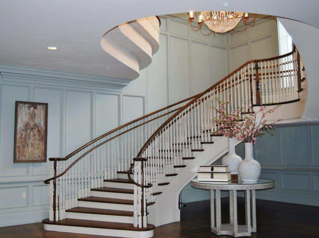 Brown and White Curved Staircase